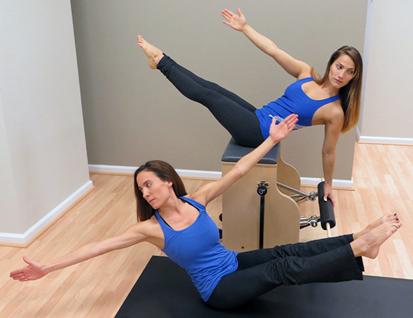 Jenny and Shannon practicing pilates