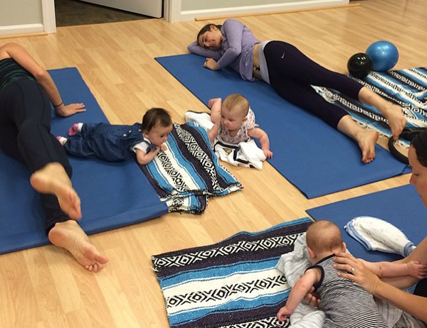 Mommies and babies practicing pilates